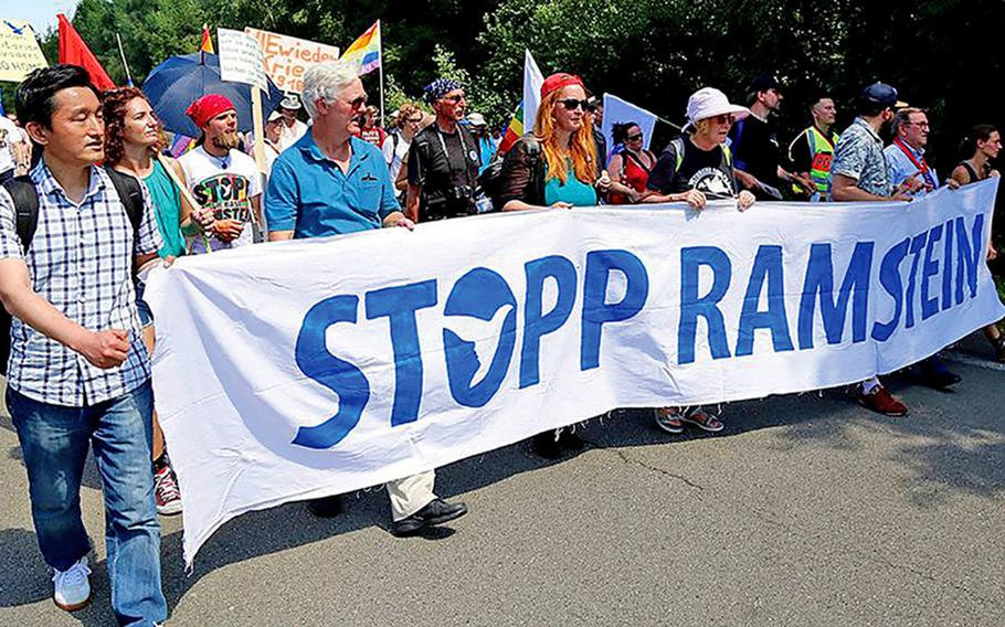 Protesters march outside Ramstein Air Base, Germany, in June 2018. Demonstrators will ride bicycles around the base on April 30 and May 1, 2021, to protest its use as a relay station for drone strikes, and call for it to be shut down.