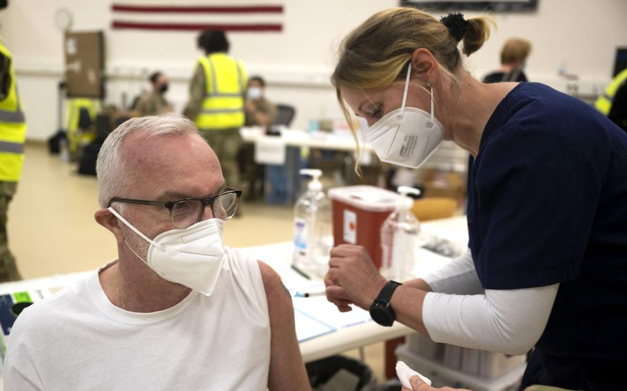 Andreas Heinze, 721st Aerial Port Squadron motor carrier safety specialist, receives a COVID-19 vaccine shot from Iris Geist, a German nurse, at Ramstein Air Base, Germany, April 29, 2021. Ramstein is the first U.S. air base in Europe to vaccinate its local national workforce.