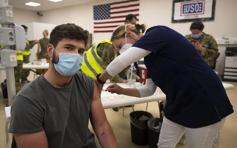 Benny Klein, 86th Civil Engineer Group accounting technician, receives a COVID-19 vaccine shot from German nurse Iris Geist at Ramstein Air Base, Germany, April 29, 2021. Ramstein is the first U.S. air base in Europe to vaccinate its local national workforce.