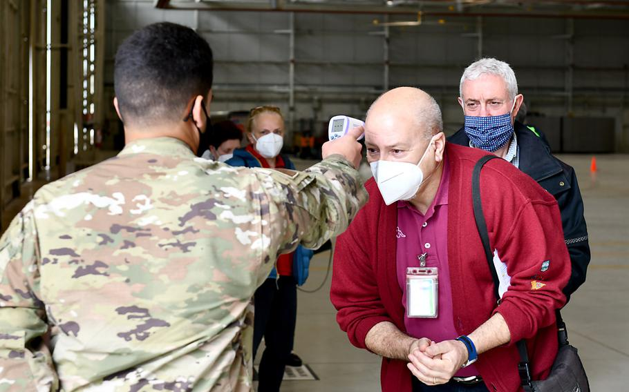 Dennis Basso-Luca, 31st Civil Engineer Squadron service contracts surveillance technician, has his temperature taken before receiving  the Moderna COVID-19 vaccine at Aviano Air Base, Italy, April 30, 2021. The base opened vaccinations to local national employees aged 60 and older on April 30, 2021.