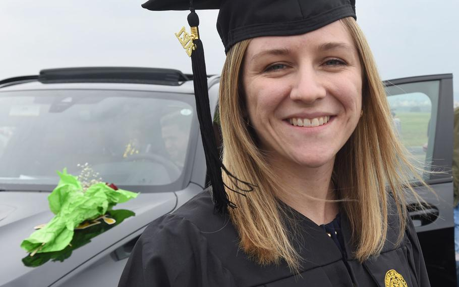 """Jessica Stevens, 32, an Army spouse from Wiesbaden, Germany, said getting her degree in human resource management was """"a relief"""" after the past year of balancing work, studies and helping her daughter with remote learning during the pandemic."""