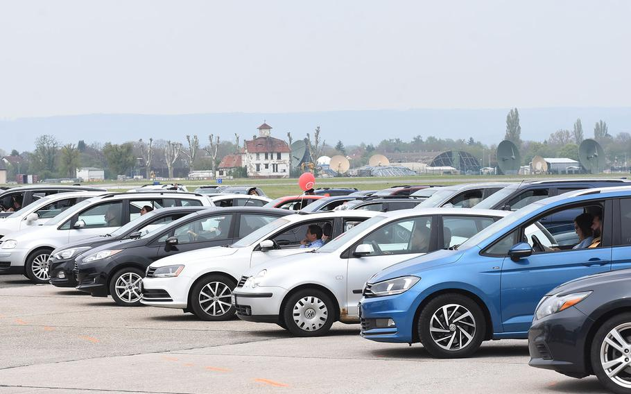 Cars of graduates and their families lined the airfield on Clay Kaserne in Wiesbaden, Germany, for the class of 2021 University of Maryland Global Campus Europe commencement ceremony on Saturday, May 1, 2021.