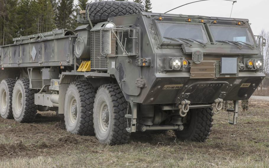 A heavy expanded mobility tactical truck associated with Bravo Battery, 1st Battalion, 77th Field Artillery Regiment, 41st Field Artillery Brigade, is positioned on Tapa Central Training Area, Estonia, for an exercise in support of Defender-Europe 21, May 3, 2021.
