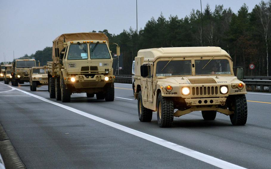 A convoy of vehicles of 3rd Armored Brigade Combat Team, 4th Infantry Division drives along a German autobahn in 2017, on its way to Poland. The U.S. has joined a European Union effort to consider ways to move troops across European national borders faster.