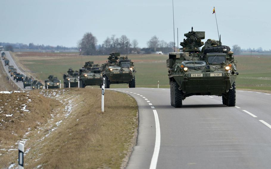 Strykers of the 2nd Cavalry Regiment convoy through Lithuania towards the Polish border in 2015. The U.S. has joined a European Union effort to consider ways to move troops across European national borders faster.