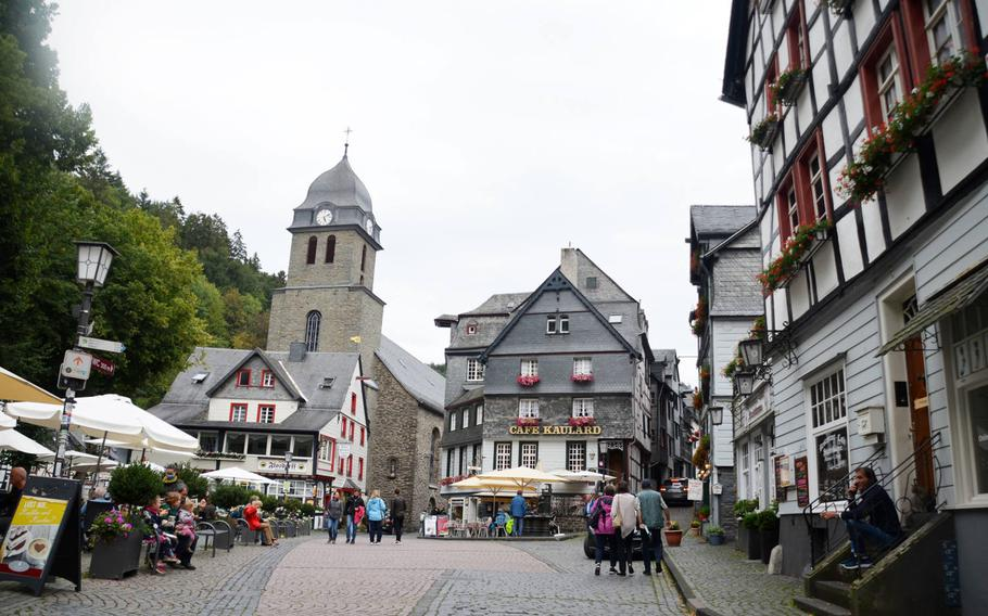 People wear masks and keep several feet away from other groups in the main square in the town of Monschau, Germany, on Sept. 1, 2020, when coronavirus infections were low. They ticked up sharply again early in 2021, but officials said on May 7, 2021, that the third wave of the virus appears to have been broken.