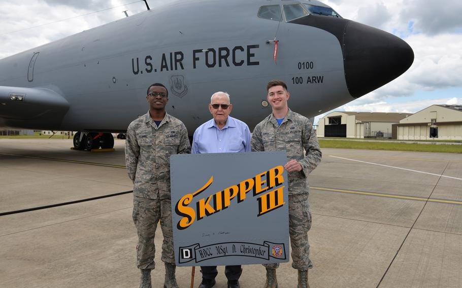 U.S. Air Force Airman 1st Class Isaiah Herring, left, 100th Aircraft Maintenance Squadron maintainer, and  Airman Camden Roman, 100th Maintenance Squadron maintainer, pose for a photo with retired Master Sgt. Dewey Christopher, at RAF Mildenhall, England, June 21, 2019.