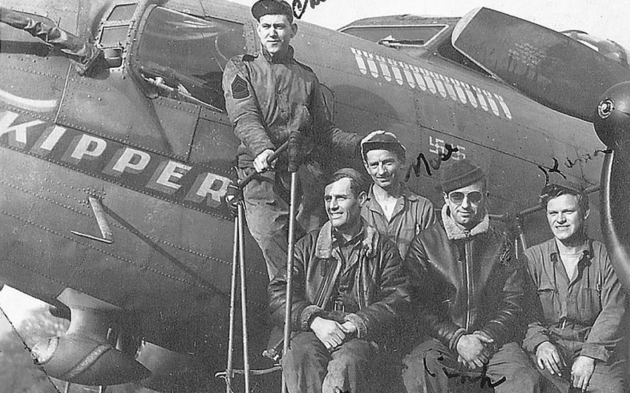 """Master Sgt. Dewey Christopher, left, poses for a photo with his ground crew and his first B-17 Flying Fortress, """"Skipper"""" at Thorpe Abbotts, Diss, England, in 1942."""