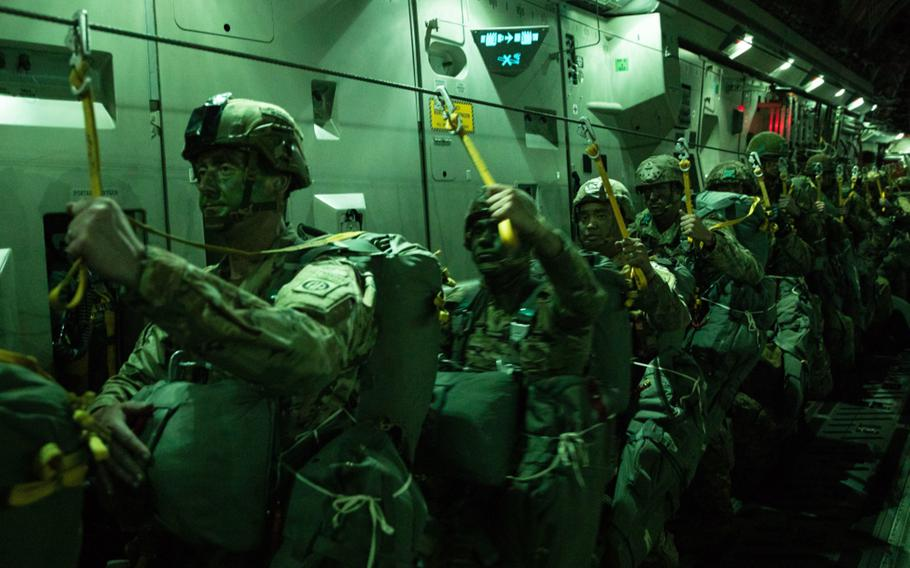 Paratroopers assigned to 3rd Brigade Combat Team, 82nd Airborne Division, wait to exit a C-17 Globemaster III bound for Estonia during Exercise Swift Response 21, May 7, 2021.