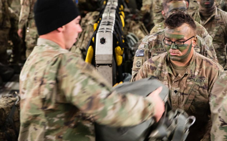 A 3rd Brigade Combat Team, 82nd Airborne Division, paratrooper receives a T-11 parachute onboard a C-17 Globemaster III aircraft bound for Estonia during Swift Response 21, May 7, 2021.