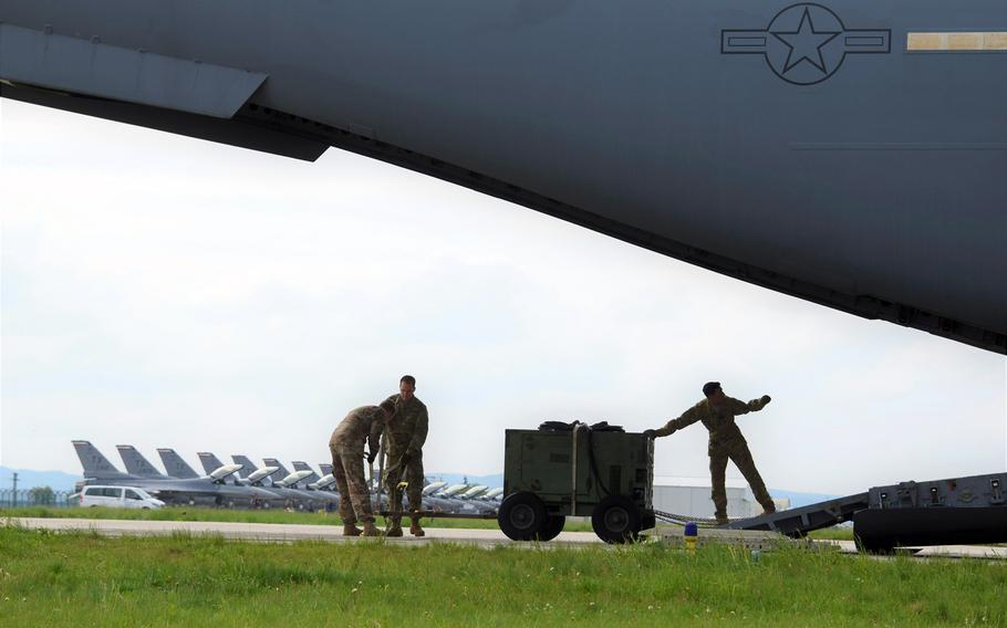A U.S. Air Force C-17 Globemaster III delivers support equipment to Campia Turzii, Romania, in 2019. The Air Force has plans to spend $152 million on upgrades to the base, including a ''dangerous cargo pad'' to support aircraft with up to 30,000 pounds in explosives.