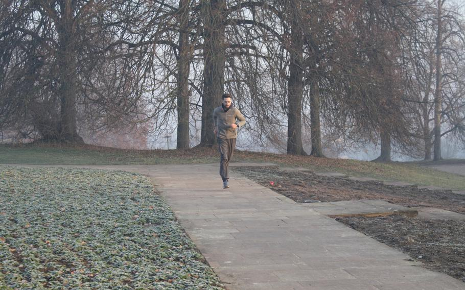 Navy veteran Dustin Johnson warms up at Stuttgart's Killesberg Park, where on Wednesday, Jan. 1, 2020, he began a 420 mile run to Berlin. Johnson is trying to complete the journey without sleep or stopping for rest over a six-day span.
