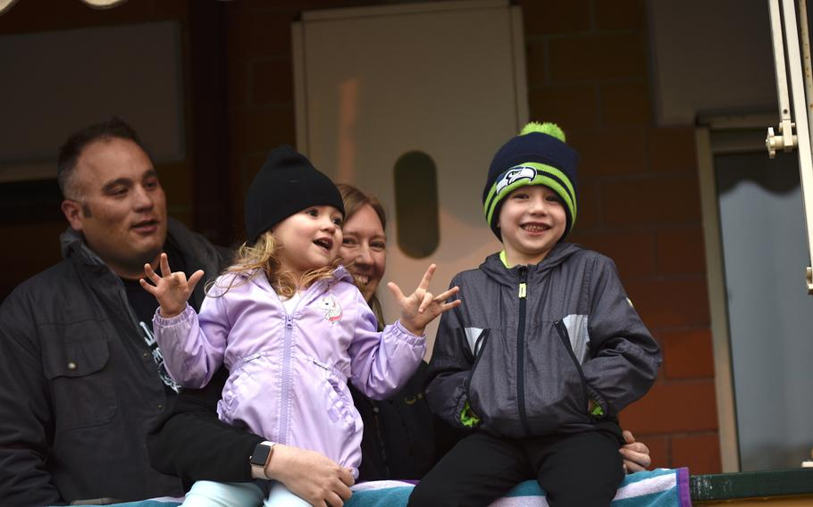 Lucas, Emelia, Tiffany and Landon Schoenborn (left to right) at the Navy's Naples Support Site take part in Operation Fun/GDT (Get Down Tonight), March 25, 2020. The singalong event is held on Wednesday and Friday evenings during the movement restrictions in place because of the coronavirus.