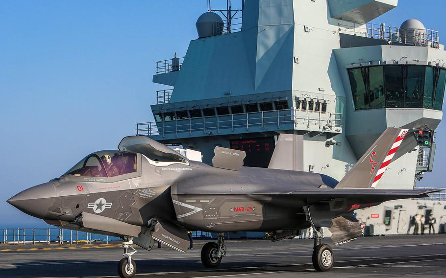 The first U.S. Marine Corps F-35B Lightning II Joint Strike Fighter lands on board the British aircraft carrier HMS Queen Elizabeth on Sept. 22, 2020, off the coast of the United Kingdom.