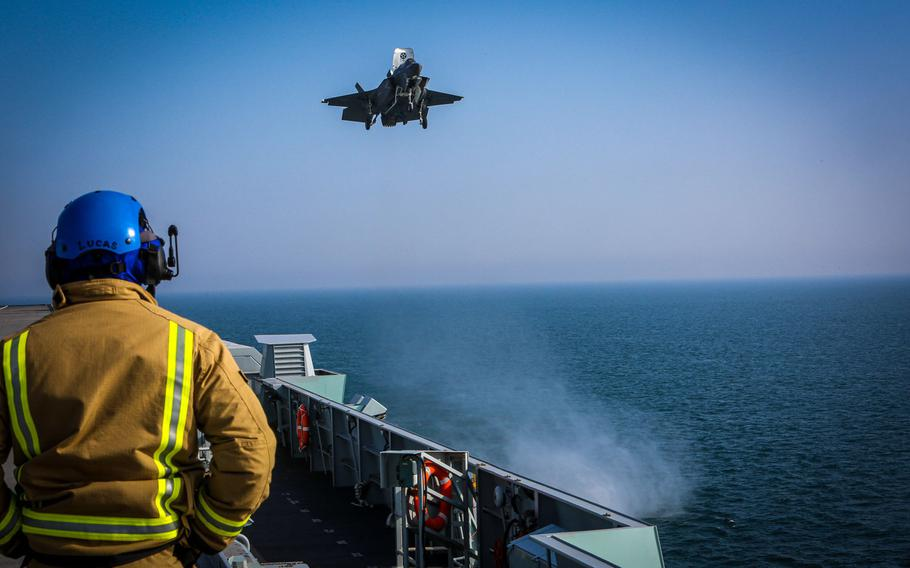 An F-35B Lightning II with Marine Fighter Attack Squadron 211 prepares to land on board HMS Queen Elizabeth off the coast of the United Kingdom on Sept. 22, 2020. The Marines of the ''Wake Island Avengers'' joined the U.K.'s 617 Squadron, ''The Dambusters,'' aboard the 65,000-ton British carrier to form the largest 5th-generation carrier air wing in the world.