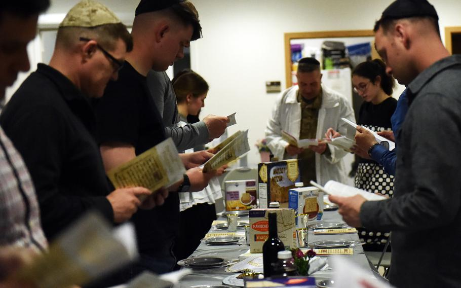 Soldiers and families read about the Exodus during a Passover celebration at Grafenwoehr, Germany, Friday, April 19, 2017.