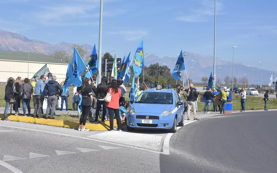 Italian national employees gathered at the traffic circle near the main gate of Aviano Air Base on Saturday, March 30, 2019, to demonstrate their unhappiness with the base on several issues. Local police were on hand to ensure access in and out of the base.