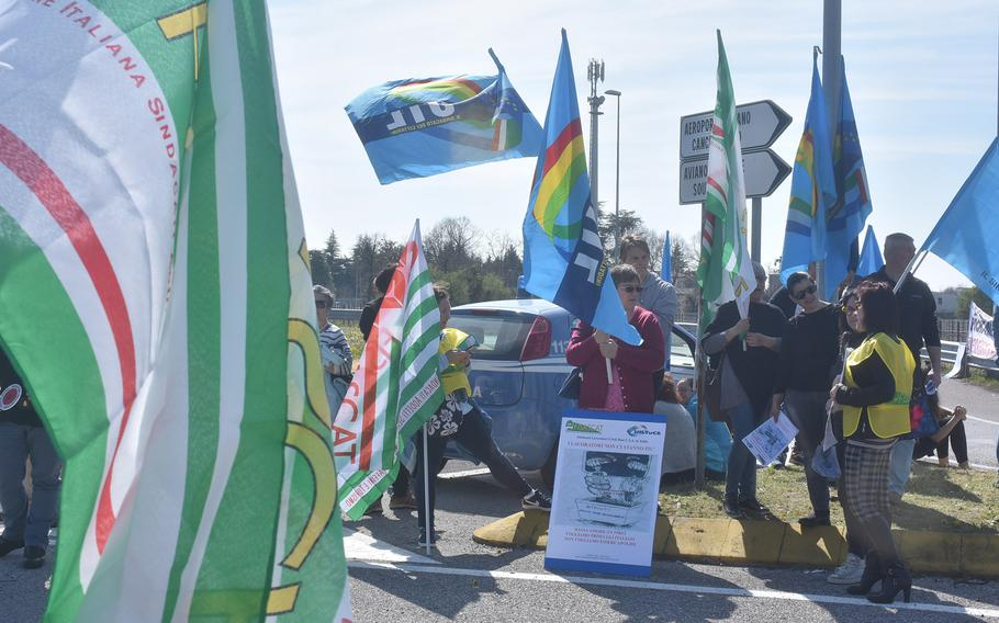 Dozens of Italians demonstrated outside the main gate of Aviano Air Base, Italy, on Saturday, March 30, 2019, calling for the base to adhere to long-standing agreements regarding employment on base.