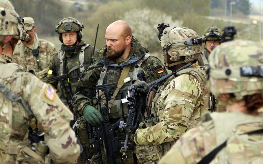 American soldiers talk with their German counterparts during exercise Allied Spirit X at Hohenfels Training Area, Germany, April 9, 2019.