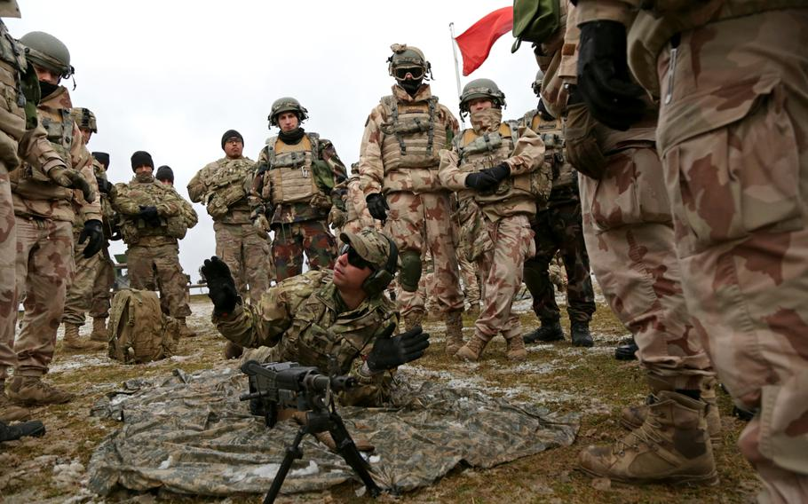 A soldier assigned to 1st Battalion, 4th Infantry Regiment instructs Hungarian soldiers on using the M240 machine gun during an exercise in Hohenfels, Germany, March 11, 2019.