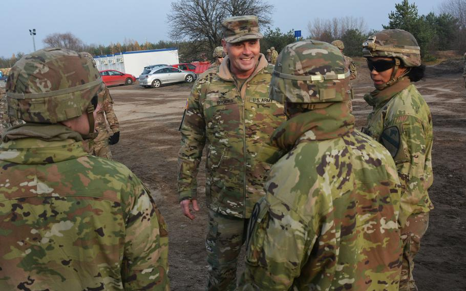 Col. Phil Brooks, 1st Infantry Division forward commander, visits with soldiers during a visit to Torun, Poland, on Nov. 27, 2019.  Brooks and Command Sgt. Maj. Joshua C. Holthus were at Torun to bring some Thanksgiving cheer to the 3rd Battalion, 16th Field Artillery Regiment of the 2nd Armored Brigade Combat Team.