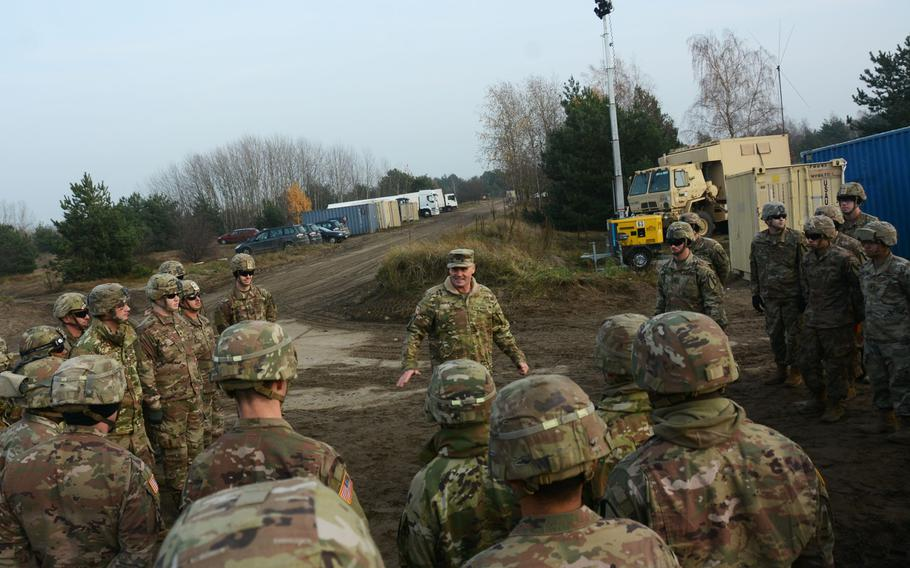 Col. Phil Brooks, 1st Infantry Division forward commander, visits with a soldiers during a Thanksgiving visit to Torun, Poland, on Nov. 27, 2019.