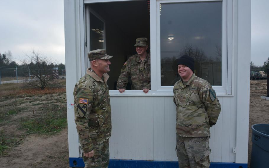 Col. Phil Brooks, 1st Infantry Division forward commander, visits with soldiers during a Thanksgiving visit to Torun, Poland, on Nov. 27, 2019.  Brooks and Command Sgt. Maj. Joshua C. Holthus, 1st Infantry Division Forward Command Sgt. Major, wanted to bring a little Thanksgiving cheer to the deployed soldiers.