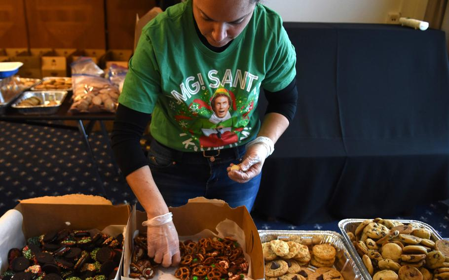 Diana Stuart, an Air Force spouse at Ramstein Air Base, Germany, sorts through a box of cookies made with pretzels and candy Thursday, Dec. 12, 2019. Thousands of cookies were donated for the annual holiday cookie drive, organized by the Ramstein Officers Spouses Club, for single and unaccompanied service members.