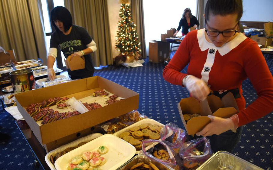Elizabeth Chambers, an Air Force spouse at Ramstein Air Base, Germany, boxes cookies on Thursday, Dec. 12, 2019, for the annual holiday cookie drive at Ramstein Air Base, Germany.