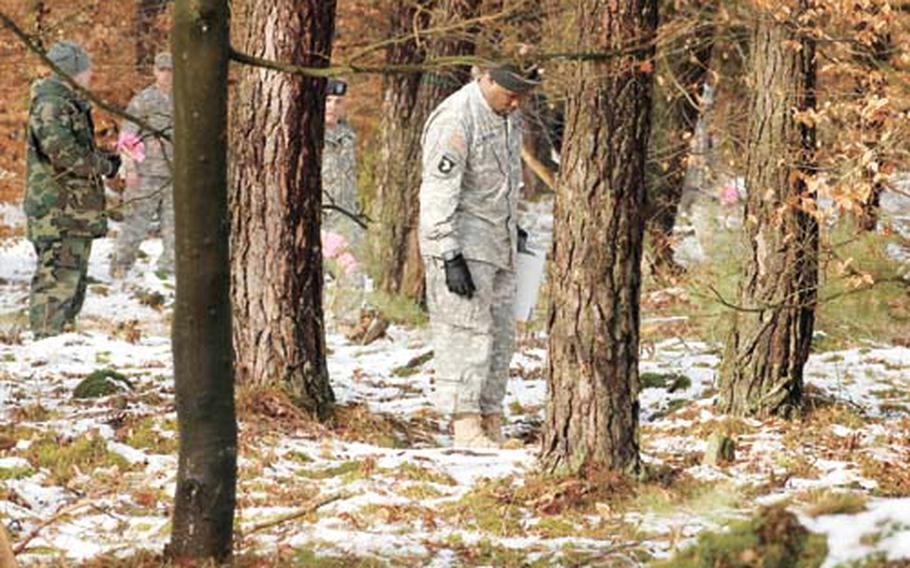 In this February photo, soldiers search the site where a U.S. Army Black Hawk helicopter crashed. The helicopter was on its way to Coleman Army Air Field in Mannheim when it went down in a thick patch of woods. Three soldiers were killed in the crash.