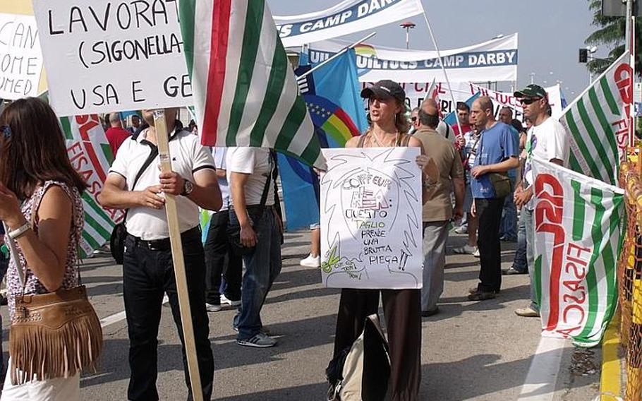 Alessandra Borrelli, a librarian on the U.S. Navy's Capodichino base in Naples, Italy, joins hundreds of Italian employees from U.S. military bases in the country who were protesting on Wednesday in Naples over job cuts announced in February.