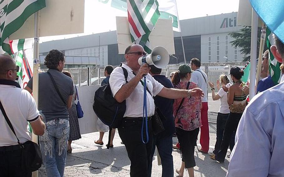 Gennaro Di Micco, a representative of the Italian CISL labor union, leads hundreds of strikers on a protest march to the front gate of the Capodichino base in Naples, Italy. Italian employees are angry over job cuts at bases in Naples and Sigonella.