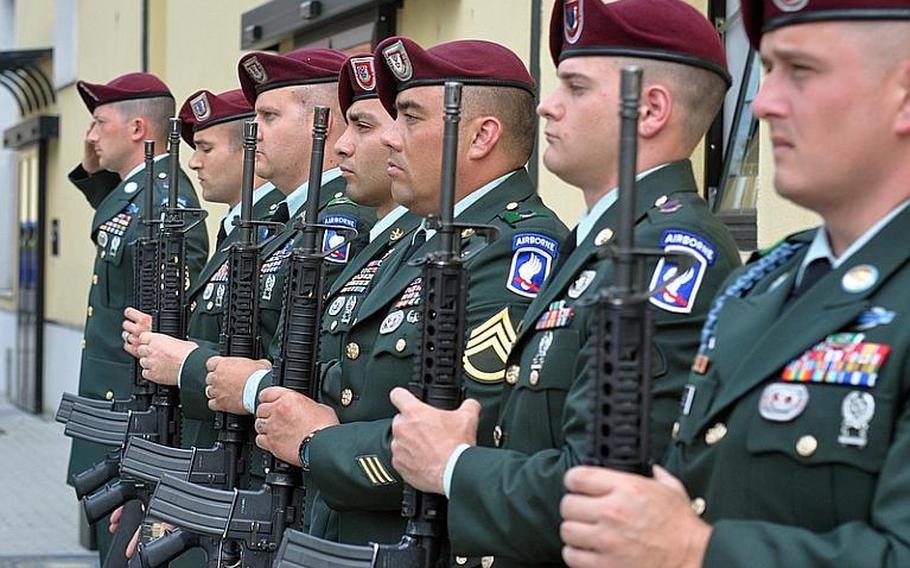 Soldiers with the 173rd Airborne Brigade Combat Team stand at attention in Vicenza, Italy, Tuesday after firing off volleys as a salute to three fellow Sky Soldiers who died in recent weeks in Afghanistan. Mourners were gathered at the nearby Caserma Ederle chapel to remember Spc. Russell E. Madden and Sgts. Matthew R. Hennigan and Louis R. Fastuca.