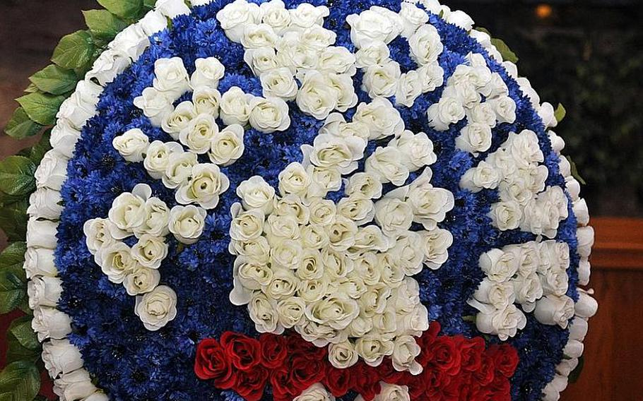 A floral representation of the 173rd Airborne Brigade Combat Team's patch was used in a ceremony Tuesday at Caserma Ederle in Vicenza, Italy, to remember three fallen Sky Soldiers.