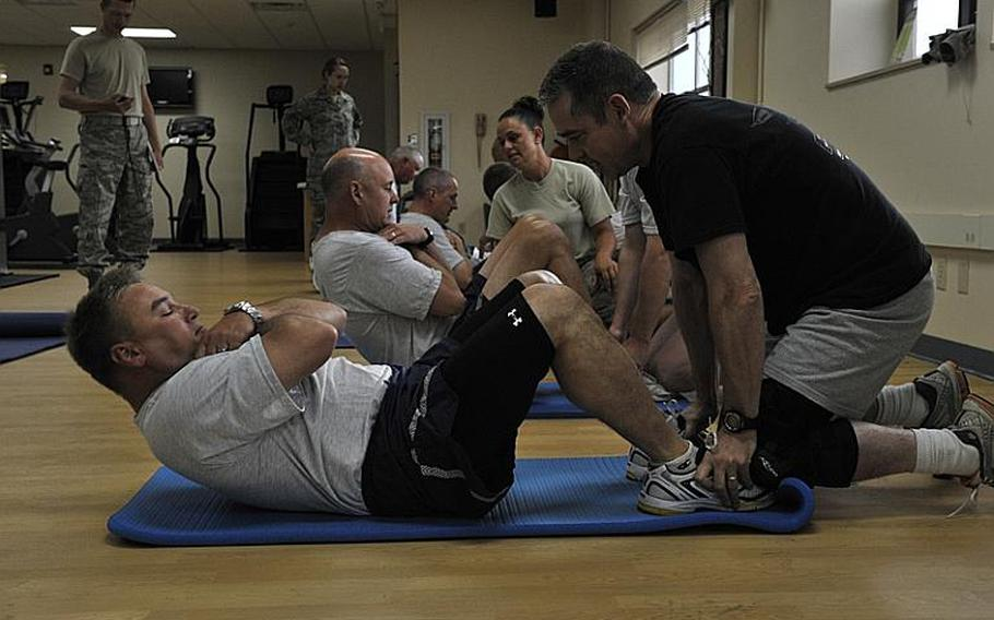 Senior leaders from the Montana Air National Guard perform the sit-up portion of the Air Force fitness test in July. Nearly one-fifth of the 30,000 active duty, reserve and National Guard airmen who took the test failed, Air Force officials said.