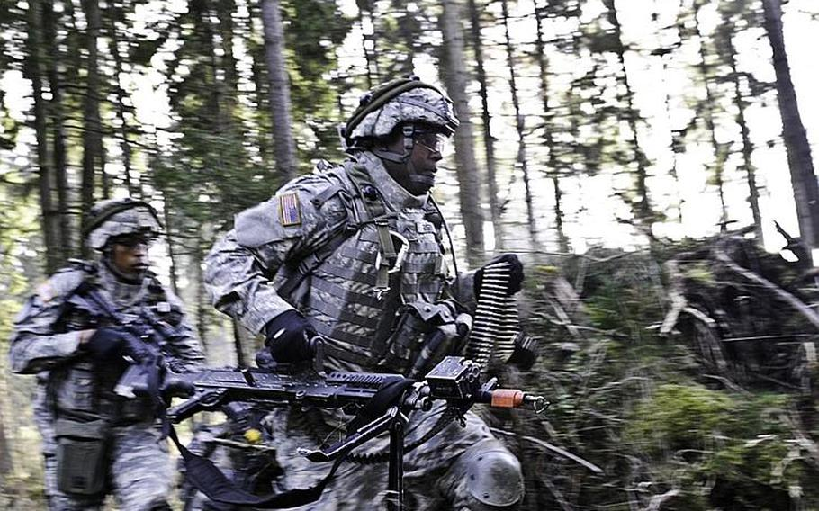 Sgt. 1st Class Zachary N. Balancier, front, and and Pvt. Christian E. Risby  of the 170th Infantry Brigade Combat Team, train in Grafenwohr, Germany, in October. The Defense Department is expected to decide early this year whether to keep the Baumholder-based 170th and the Schweinfurt-based 172nd Infantry Brigade Combat Team in Europe.