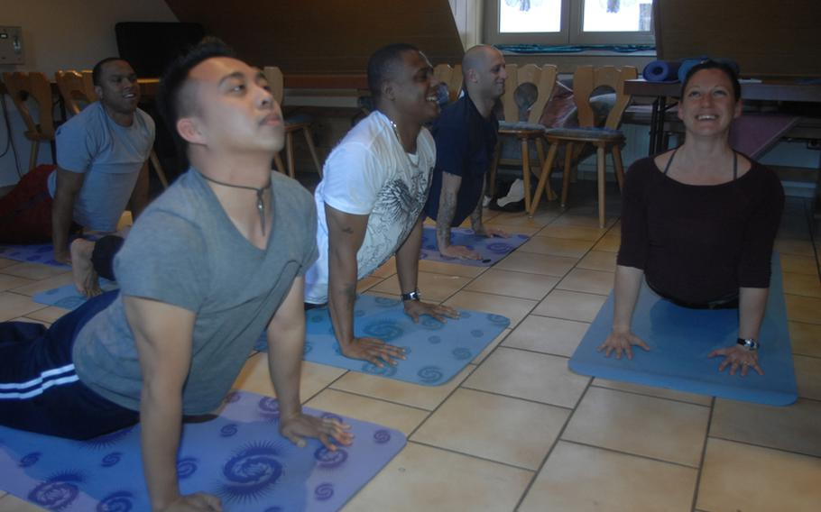 From left: Staff Sgt. Lincoln Manning, in background, 30, of New York; Sgt. Mark Coloma, 28, of Honolulu; Sgt. 1st Class Milton Johnson, 36, of Chicago and Staff Sgt. Neil Kessler, 32, of Albany, N.Y., learn yoga with the help of instructor Sarah Brown near Grafenwoehr, Germany, on Wednesday.