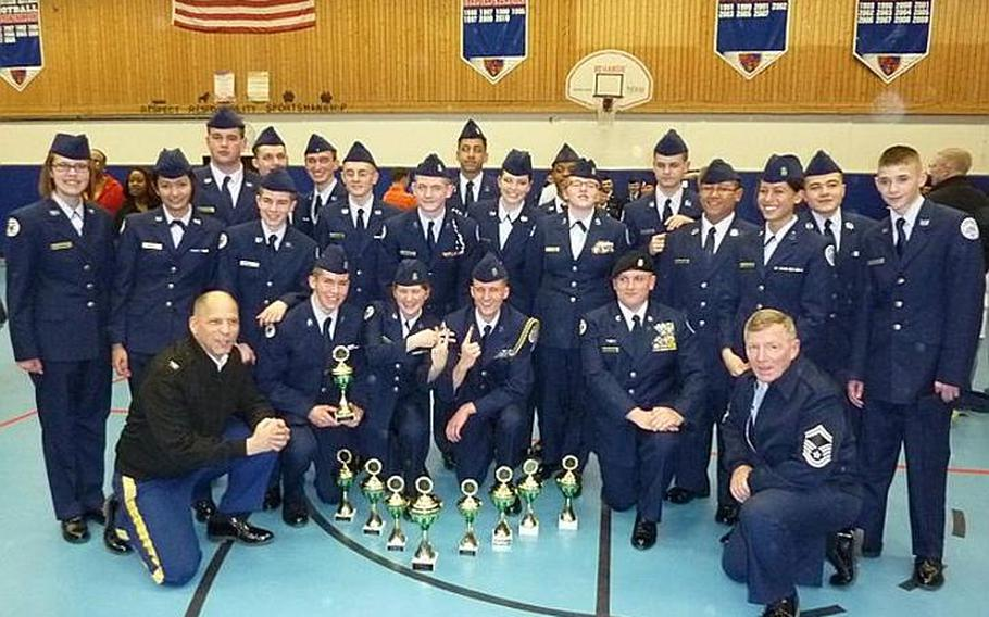 Members of the Junior Reserve Officers' Training Corps drill team at Wiesbaden High School pose with their instructors after winning the annual drill competition for all Navy and Air Force ROTC  programs  in the Department of Defense Dependents Schools in Europe last weekend in Ramstein, Germany.