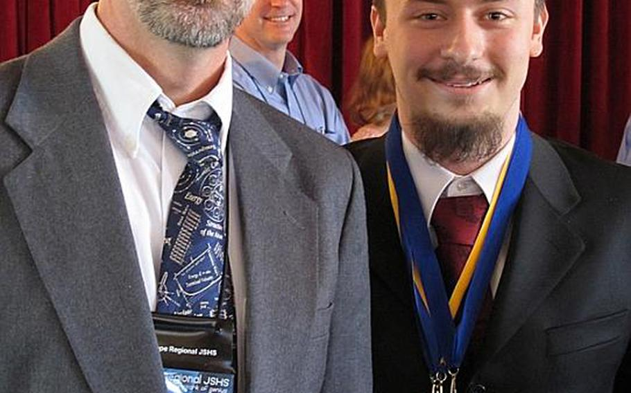 Kevin Burdge, right, first-place oral presentation winner at the 37th Annual Junior Science and Humanities Symposium, poses with  Ray Smola, a Heidelberg High School teacher, after winning his award. Burdge will represent the Department of Defense Dependents Schools-Europe at the national JSHS symposium in San Diego this month.
