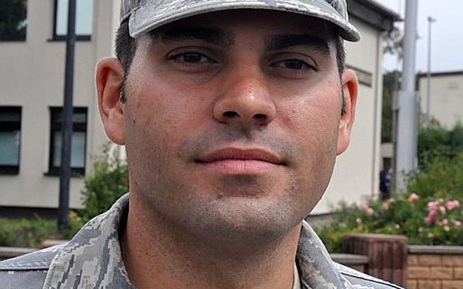 Air Force Master Sgt. Carlos Pubillones, of USAFE headquarters, said he watched 10 years ago from his home in Queens, N.Y., as smoke billowed from the World Trade Center towers. Pubillones took part in a ceremony at Ramstein Air Base Friday, which commemorated the 10th anniversary of the 9/11 attacks.