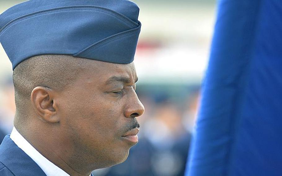 Chief Master Sgt. Zef Smith, command chief of the 86th Airlift Wing, shuts his eyes during a prayer. The prayer was part of a ceremony, held at Ramstein Air Base Friday, which commemorated the10th anniversary of the attacks on Sept. 11.