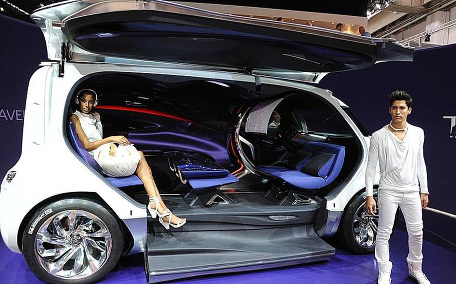 French automobile maker Citroën is showing off its Tubik, a hybrid concept van, at the Frankfurt International Motor Show. The Tubik, which seats nine, features a lounge-like interior, an egg shaped driver's area, fold down seats made of felt and silk and a leather floor.
