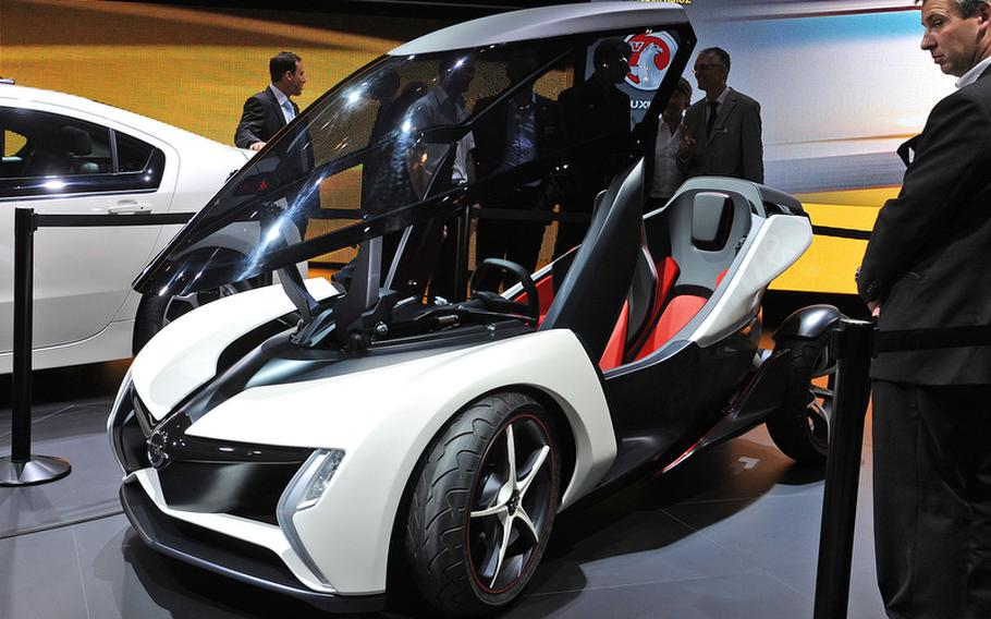 The Opel RAK e concept car is a two-seater, with a single passenger sitting behind the driver, like on a motorcycle. It was one of many small, energy-efficient two-seaters presented by auto makers at the Frankfurt International Motor Show.