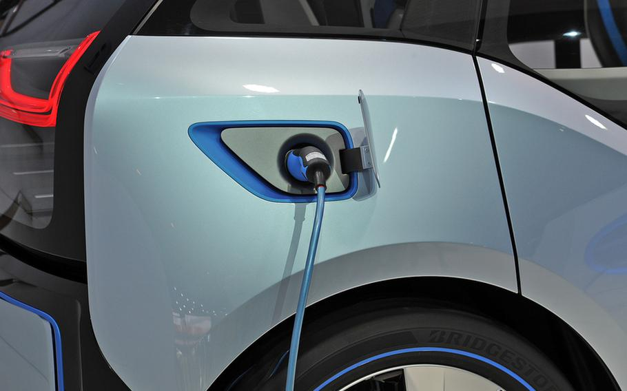 Electric plugs instead of gas nozzles may be the way of the future, at least for traveling short distances, as seen here on the BMW i3 Concept, shown here at the Frankfurt International Motor Show.