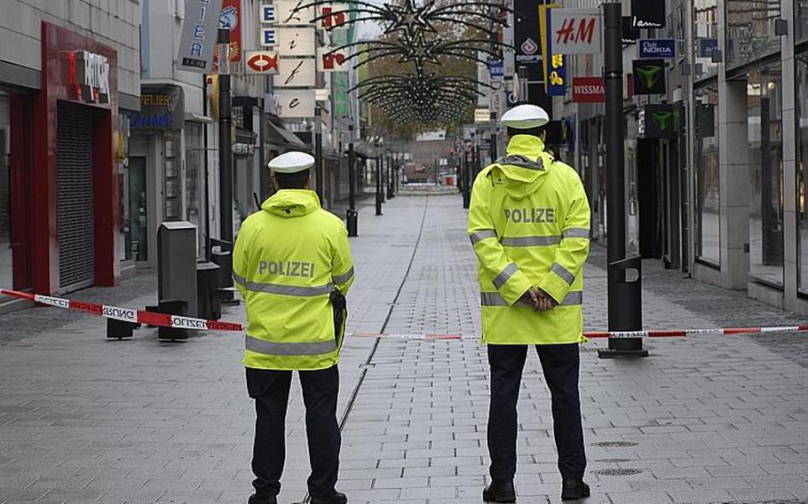 A pair of policemen guard the boundary of an evacuation zone in Koblenz, Germany on Dec. 4, 2011. About 45,000 residents in Koblenz were evacuated as bomb disposal experts began to defuse a 4,000 pound bomb, believed to have been dropped by the British Royal Air Force during World War II.