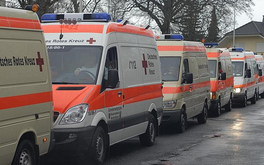 Ambulances line the street in front of a nursing home in Koblenz, Germany.  Residents of the home were among about 45,000 in the city who were ordered to leave for several hours Dec. 4, 2011, as authorities worked to defuse World War II ordnance, recently discovered in the area.
