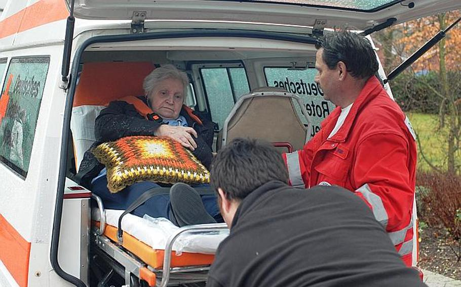 A resident of a nursing home receives help from medical personnel. The home was one of seven homes for the elderly that had to be evacuated after a recent discovery of a 4,000 pound bomb, dropped during World War II, in the Rhine River. Authorities ordered the evacuation while experts worked to deactivate the bomb Dec. 4, 2011.