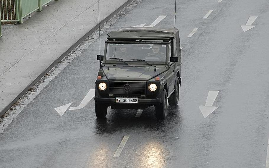 German Army soldiers have the road all to themselves on one of Koblenz, Germany's main streets Dec. 4, 2011.  Authorities evacuated about 45,000 residents of the city while experts worked to deactivate World War II ordnance discovered in the area.