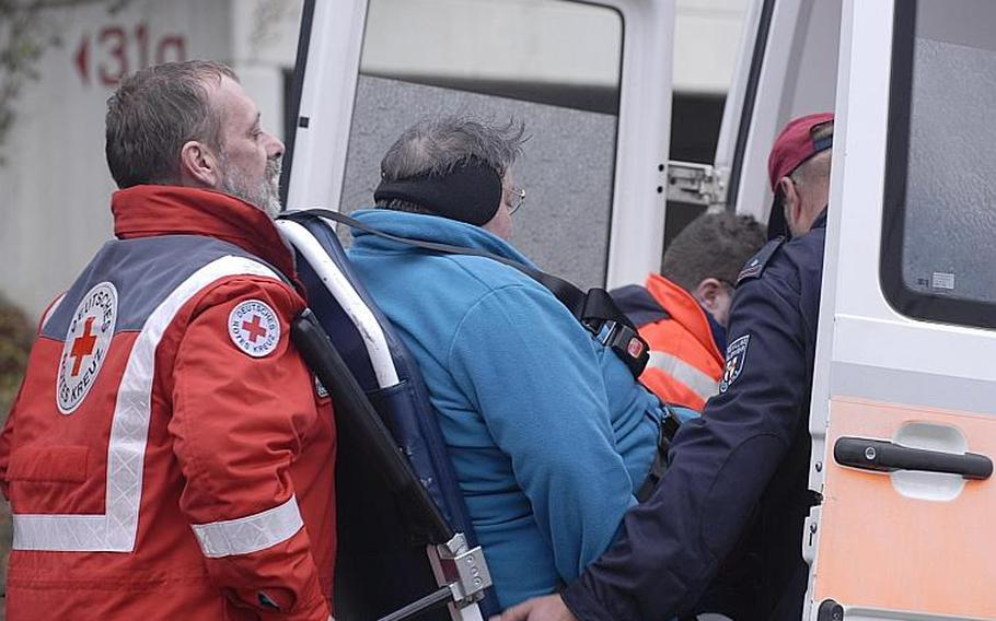 A Koblenz resident receives help from German Red Cross workers. She was among about 45,000 residents of the city ordered to leave their homes for a few hours Dec. 4, 2011, as experts worked to to defuse bombs found recently that were dropped during World War II.