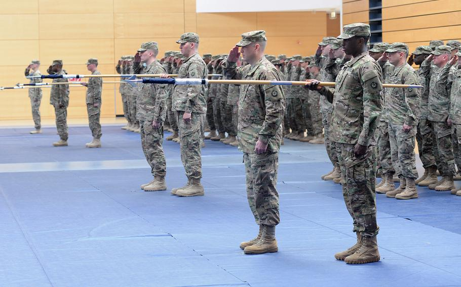 Soldiers of V Corps salute during the presentation of colors at the beginning of the unit's casing of the colors ceremony at Wiesbaden Army Airfield, Germany, on Thursday. The corps is headed for an Afghanistan deployment and is leaving Germany for good after more than 60 years.